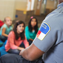 Police officer teaching elementary school children about safety